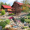 Glaciers' Mountain Resort - finest Cabins around - Exceptionally-priced cabins for Glacier visitors. Balcony & decks showcase wildlife, enjoy fishing & rafting down the street. Amtrak stop 5 minutes away. Gorgeous gardens.